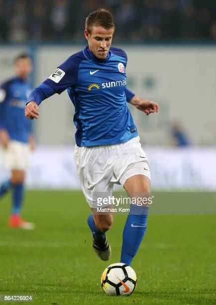 Tommy Grupe of Rostock runs with the ball during the third league match between FC Hansa Rostock and VfL Osnabrueck at Ostseestadion on October 20...