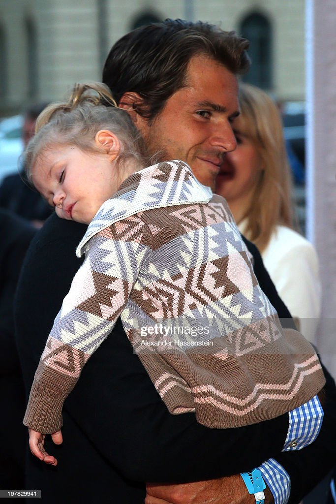 Tommy Haas arrives with his daughter Valentina for the BMW Open Players Night at Lazy Moon Dinner Club on April 30 2013 in Munich Germany