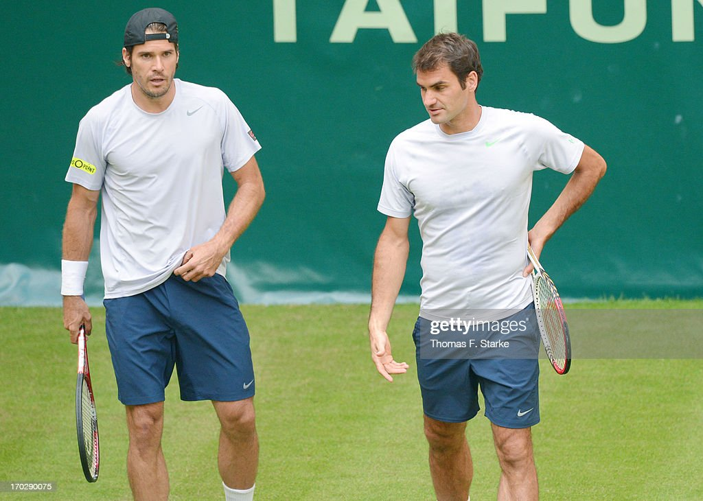Tommy Haas Germany and Roger Federer of Switzerland look dejected during their first round doubles match against Jurgen Melzer of Austria and Philipp...