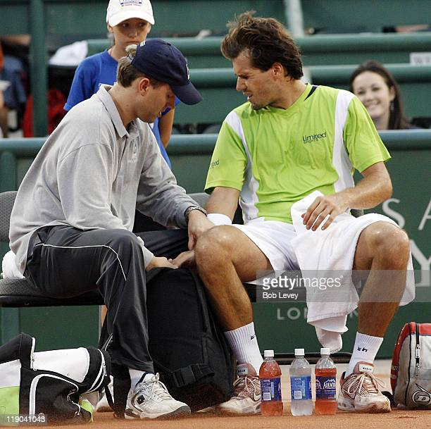 Tommy Haas is treated by ATP trainer Clay Sniteman for a wrist injury that caused him to retire in the 1st setMardy Fish defeated Tommy Haas 41 in...