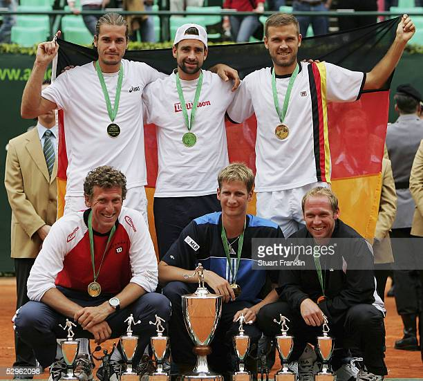 Tommy Haas Nicolas Kiefer Alexander Waske Patrick Kuehnen Florian Mayer and Rainer Schuettler of Germany with the trophy for winning The ARAG World...