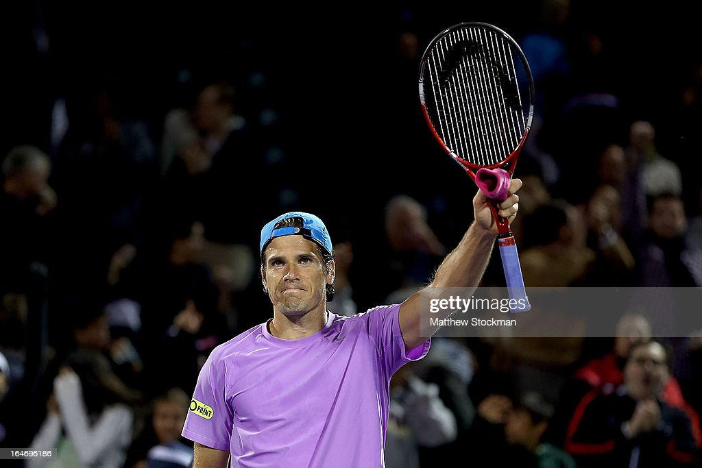 Tommy Haas of Germany acknowledges the crowd after defeating Novak Djokovic of Serbia during the Sony Open at Crandon Park Tennis Center on March 26, 2013 in Key Biscayne, Florida.