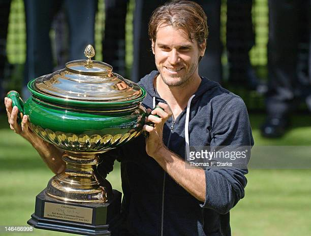Tommy Haas of Germany celebrates his victory in the final match against Roger Federer of Switzerland during day seven of the Gerry Weber Open at...