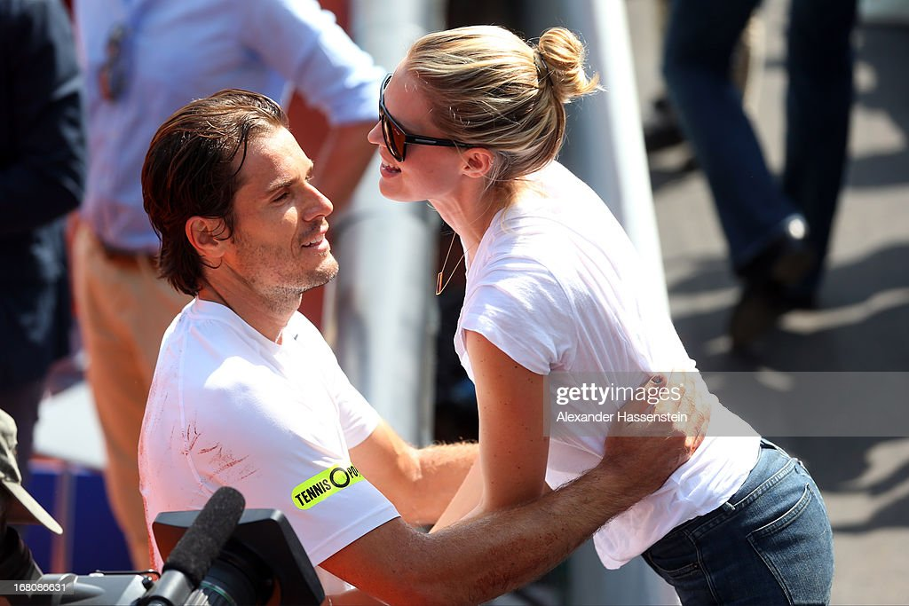 Tommy Haas of Germany celebrates with his wife Sara Foster after winning his final match against Philipp Kohlschreiber of the BMW Open at Iphitos...