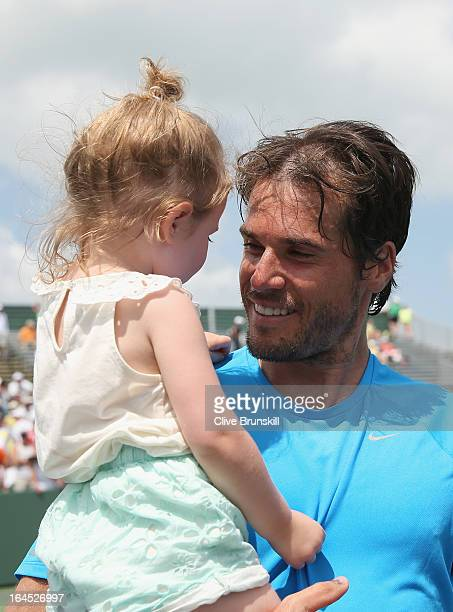 Tommy Haas of Germany holds his daughter Valentina after his straight set victory against Alexandr Dolgopolov of the Ukraine during their third round...
