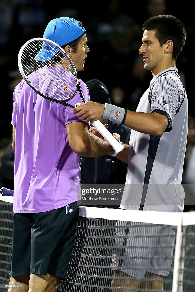 Tommy Haas of Germany is congratulated by <a gi-track='captionPersonalityLinkClicked' href=/galleries/search?phrase=Novak+Djokovic&family=editorial&specificpeople=588315 ng-click='$event.stopPropagation()'>Novak Djokovic</a> of Serbia after their match during the Sony Open at Crandon Park Tennis Center on March 26, 2013 in Key Biscayne, Florida.