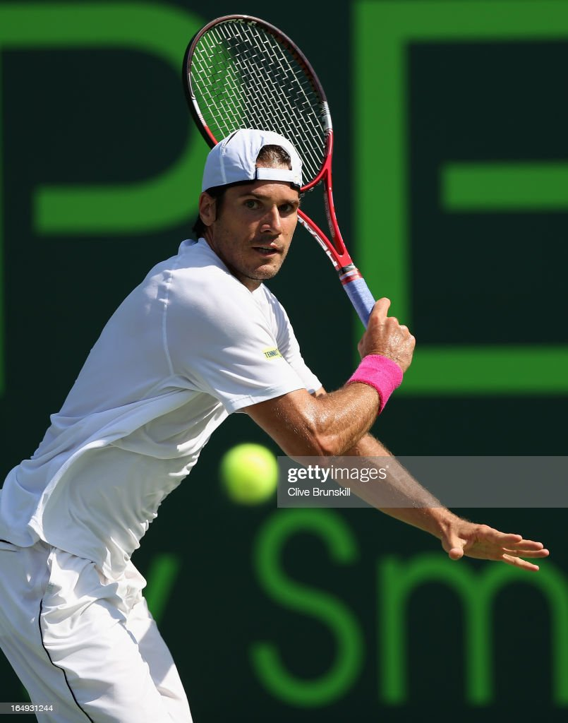 Tommy Haas of Germany lines up a backhand against David Ferrer of Spain during their semi final match at the Sony Open at Crandon Park Tennis Center...