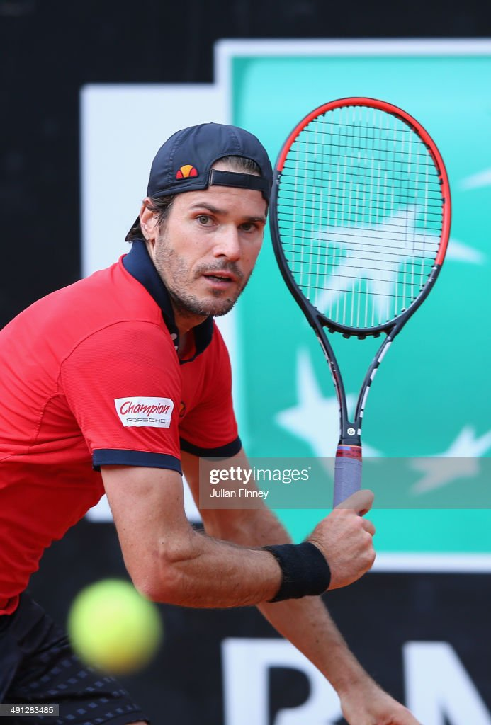Tommy Haas of Germany plays a backhand in his match against Grigor Dimitrov of Bulgaria during day six of the Internazionali BNL d'Italia tennis 2014...