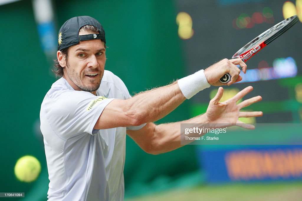 Tommy Haas of Germany plays a backhand in his quarter final match against Gael Monfils of France during day five of the Gerry Weber Open at Gerry...