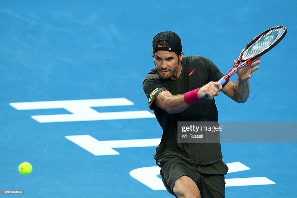 Tommy Haas of Germany plays a backhand in his singles match against Novak Djokovic of Serbia during day seven of the Hopman Cup at Perth Arena on January 4, 2013 in Perth, Australia.