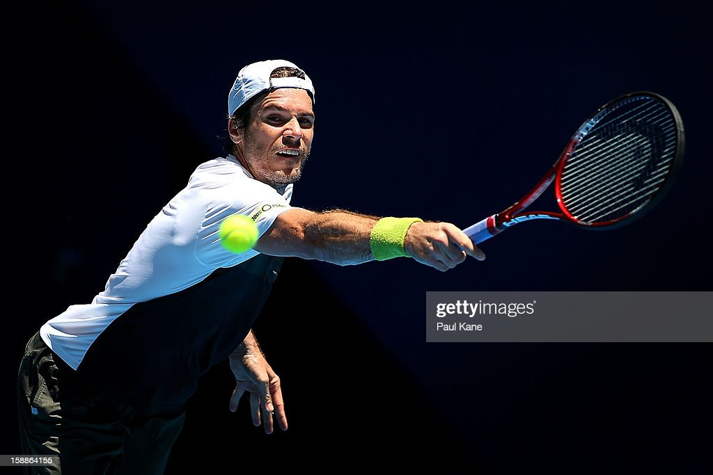 <a gi-track='captionPersonalityLinkClicked' href=/galleries/search?phrase=Tommy+Haas&family=editorial&specificpeople=171956 ng-click='$event.stopPropagation()'>Tommy Haas</a> of Germany plays a backhand to Andreas Seppi of Italy in his singles match during day five of the Hopman Cup at Perth Arena on January 2, 2013 in Perth, Australia.