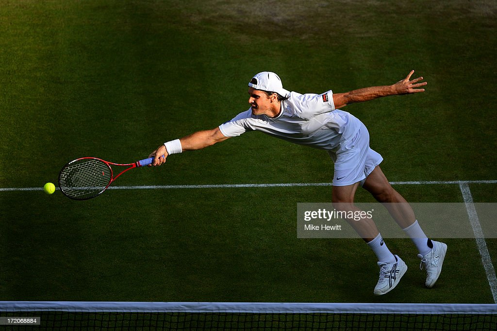 Tommy Haas of Germany plays a forehand during the Gentlemen's Singles fourth round match against Novak Djokovic of Serbia on day seven of the Wimbledon Lawn Tennis Championships at the All England Lawn Tennis and Croquet Club on July 1, 2013 in London, England.