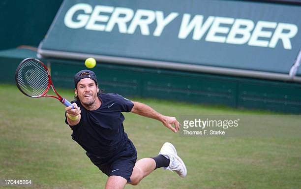 Tommy Haas of Germany plays a forehand in his match against Ernests Gulbis of Latvia during day four of the Gerry Weber Open at Gerry Weber Stadium...