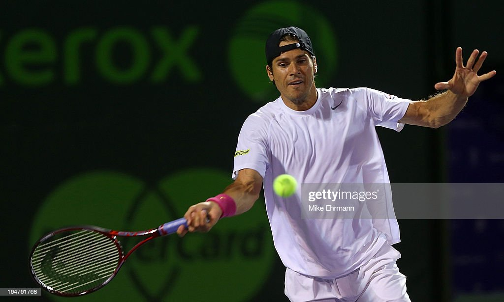 Tommy Haas of Germany plays a match against Gilles Simon of France during Day 10 of the Sony Open at Crandon Park Tennis Center on March 27, 2013 in Key Biscayne, Florida.