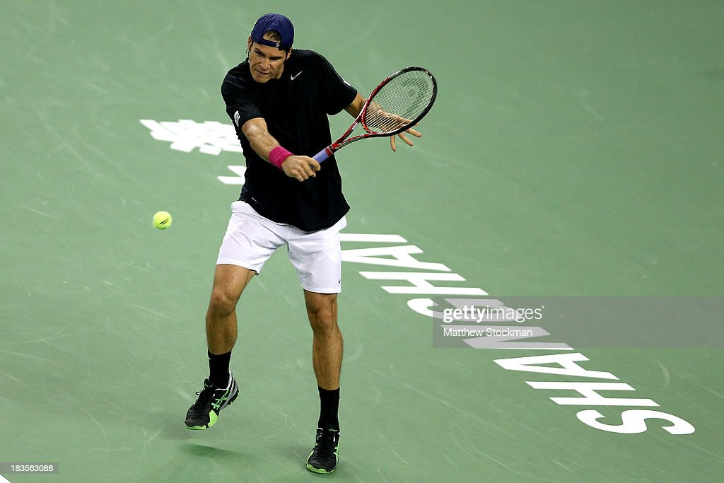 Tommy Haas of Germany returns a shot to Sam Querrey of the United States during the Shanghai Rolex Masters at the Qi Zhong Tennis Center on October 7, 2013 in Shanghai, China.