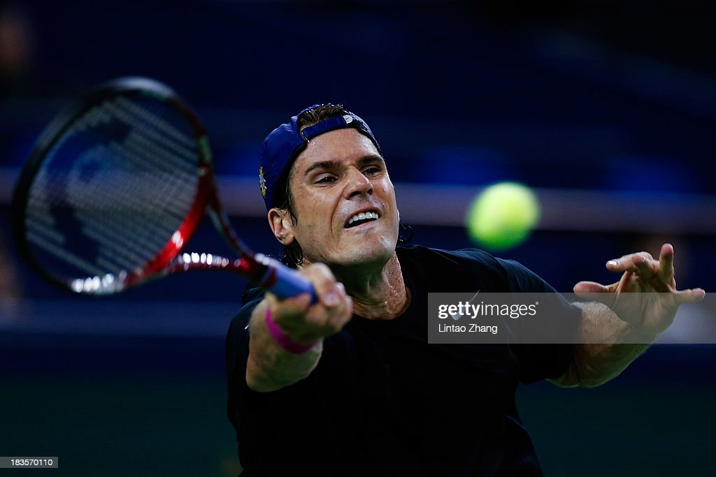 Tommy Haas of Germany returns a shot to Sam Querrey of the United States during day one of the Shanghai Rolex Masters at the Qi Zhong Tennis Center on October 7, 2013 in Shanghai, China.