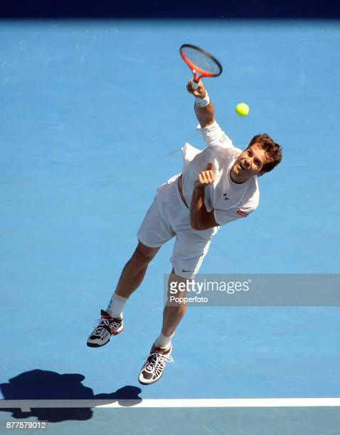 Tommy Haas of Germany serves against Rafael Nadal of Spain during a Men's Singles 2nd round match on day three of the 2012 Australian Open at...