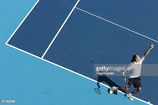 Tommy Haas of Germany serves during practice at the Athens 2004 Summer Olympic Games at the Olympic Sports Complex Tennis Centre on August 12 2004 in...