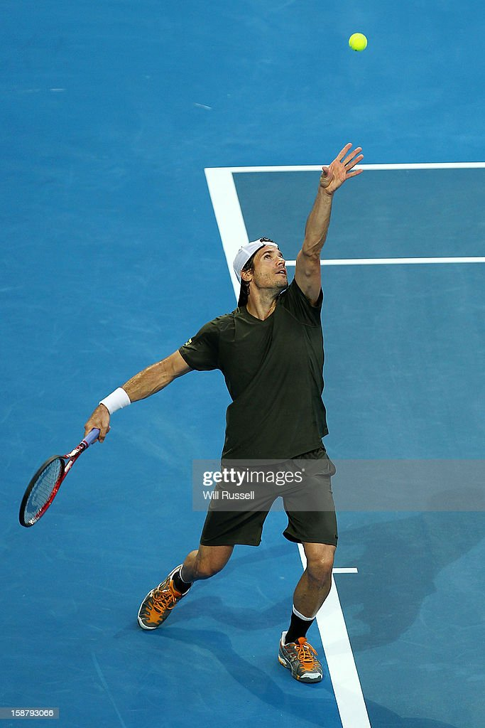 Tommy Haas of Germany serves in his singles match against Bernard Tomic of Australia during day one of the Hopman Cup at Perth Arena on December 29, 2012 in Perth, Australia.
