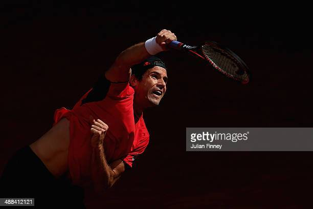 Tommy Haas of Germany serves to Igor Sijsling of Holland during day four of the Mutua Madrid Open tennis tournament at the Caja Magica on May 6 2014...