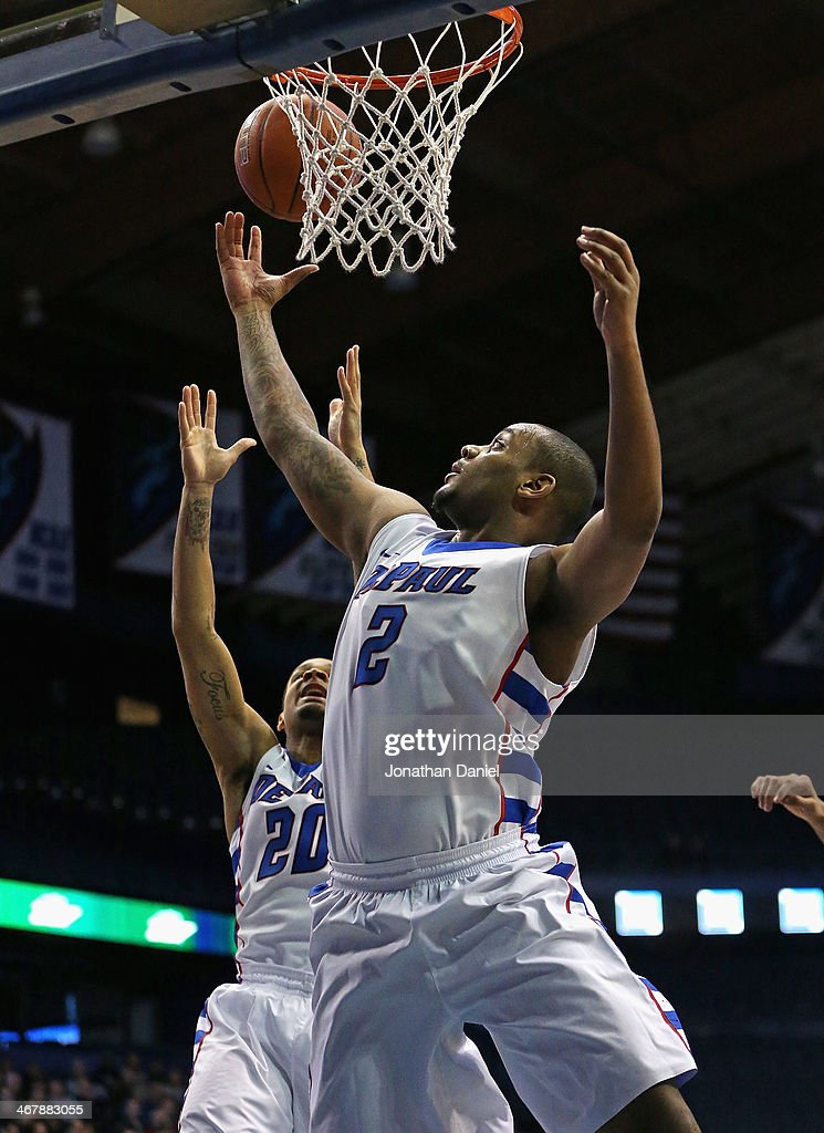 Tommy Hamilton IV #2 of the DePaul Blue Demons rebounds next to teammate Brandon Young #20 against the Georgetown Hoyas at the Allstate Arena on February 3, 2014 in Rosemont, Illinois. Georgetown defeated DePaul 71-59.
