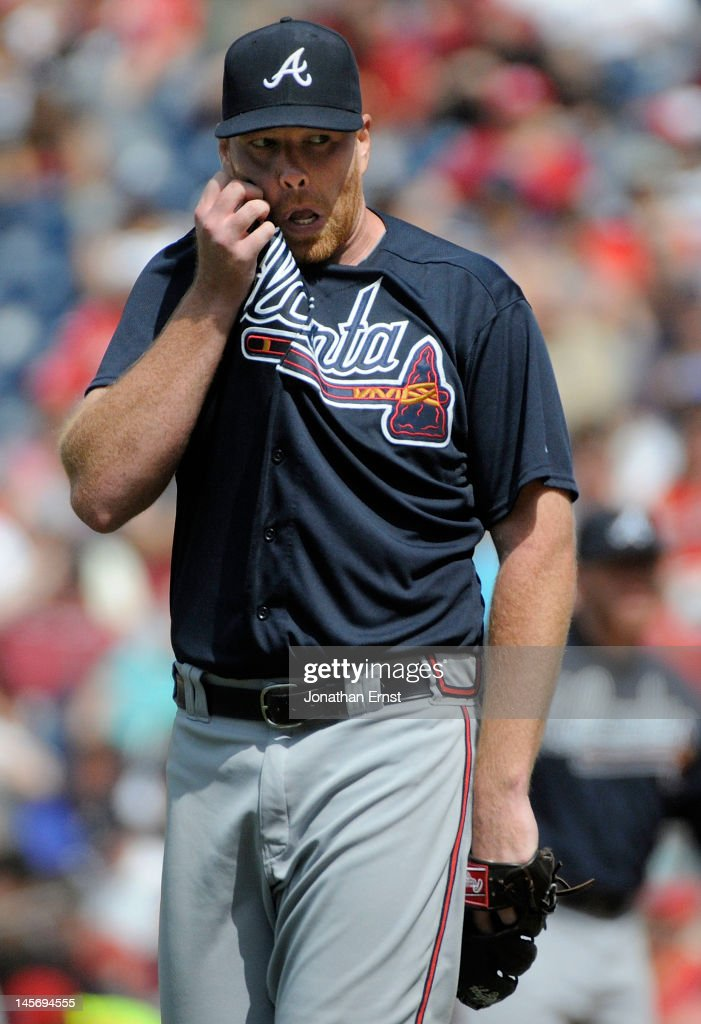 <a gi-track='captionPersonalityLinkClicked' href=/galleries/search?phrase=Tommy+Hanson&family=editorial&specificpeople=3358060 ng-click='$event.stopPropagation()'>Tommy Hanson</a> #48 of the Atlanta Braves pauses to wipe his face between pitches against the Washington Nationals during the seventh inning of their game at Nationals Park on June 3, 2012 in Washington, DC.