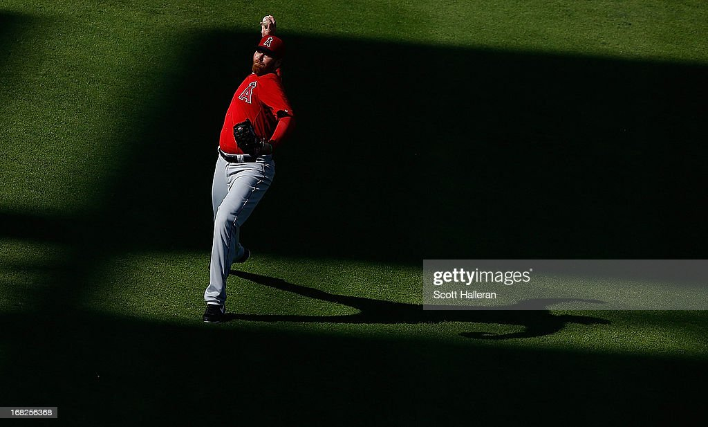 <a gi-track='captionPersonalityLinkClicked' href=/galleries/search?phrase=Tommy+Hanson&family=editorial&specificpeople=3358060 ng-click='$event.stopPropagation()'>Tommy Hanson</a> #48 of the Los Angeles Angels of Anaheim works out in the outfield prior to the start of the game against the Houston Astros at Minute Maid Park on May 7, 2013 in Houston, Texas.