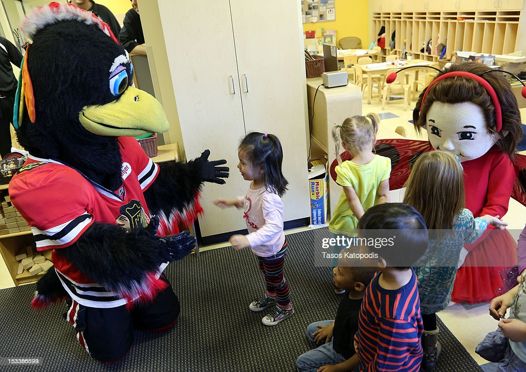 Tommy Hawk and Lady Bug Girl plays with children at Bright Horizons on October 4, 2012 in Chicago, Illinois.