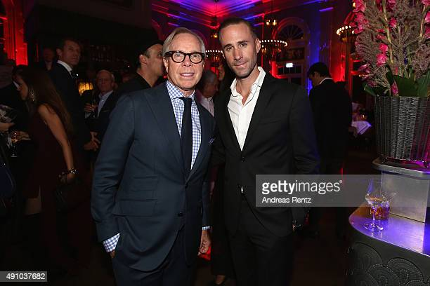 Tommy Hilfiger and actor Joseph Fiennes attend the Tommy Hilfiger VIP Dinner during the Zurich Film Festival on October 2 2015 in Zurich Switzerland...