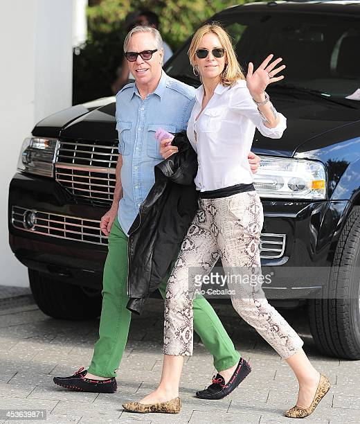 Tommy Hilfiger and Dee Ocleppo are seen on December 4 2013 in Miami Beach Florida