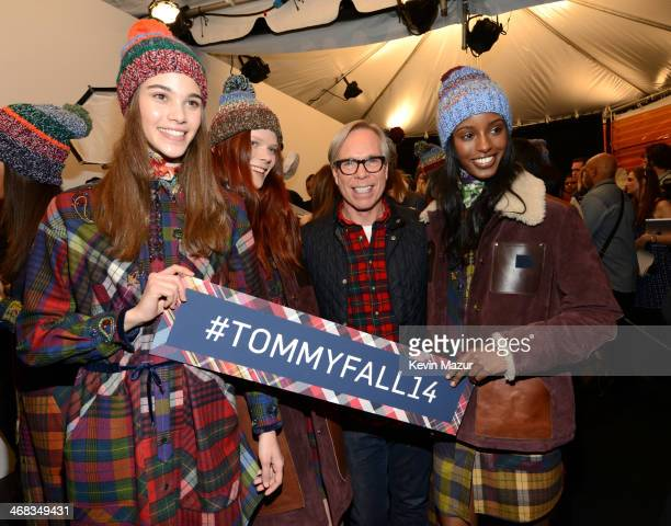 Tommy Hilfiger and models backstage at Tommy Hilfiger Presents Fall 2014 Women's Collection on February 10 2014 in New York United States