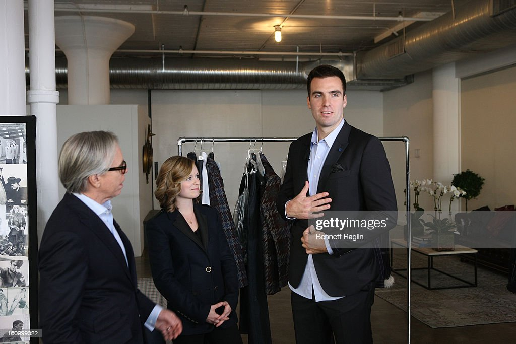 Tommy Hilfiger, Baltimore Ravens Quarterback <a gi-track='captionPersonalityLinkClicked' href=/galleries/search?phrase=Joe+Flacco&family=editorial&specificpeople=4645672 ng-click='$event.stopPropagation()'>Joe Flacco</a> (R) and wife Dana Flacco get ready for Fashion Week at Hudson Studios on February 7, 2013 in New York City.