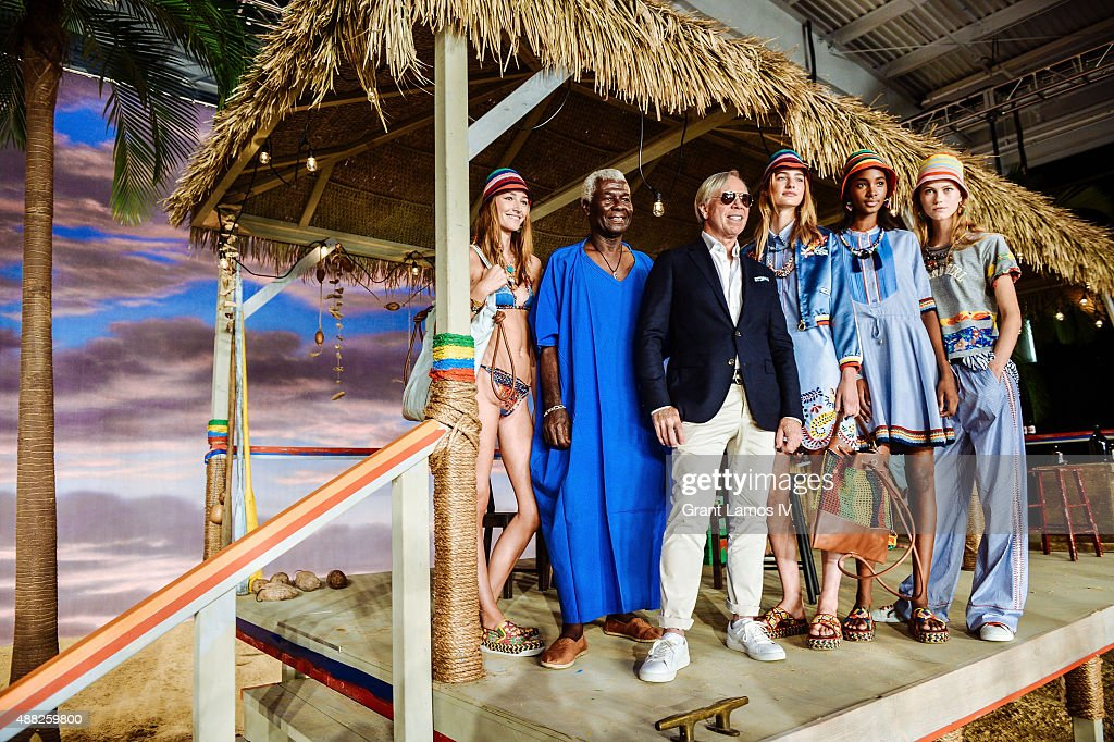 Tommy Hilfiger poses with models at the Tommy Hilfiger Women's show during Spring 2016 New York Fashion Week at Pier 36 on September 14 2015 in New...