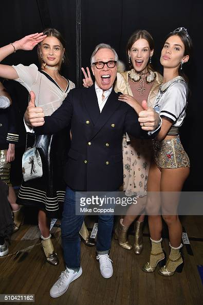Tommy Hilfiger poses with models backstage at the Tommy Hilfiger Women's Fall 2016 show during New York Fashion Week The Shows at Park Avenue Armory...