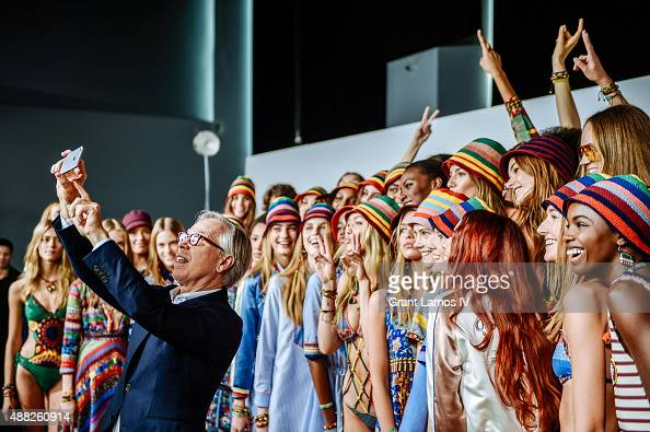 Tommy Hilfiger takes a selfie with models backstage at the Tommy Hilfiger Women's show during Spring 2016 New York Fashion Week at Pier 36 on...