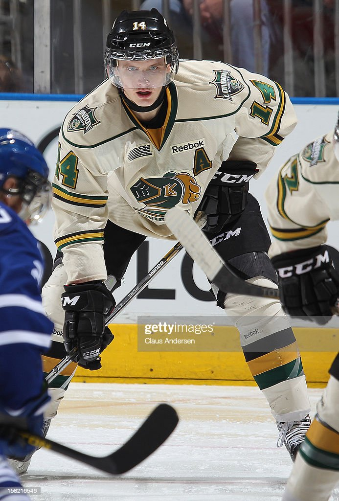 Tommy Hughes #14 of the London Knights waits for a faceoff in an OHL game against the Mississauga Steelheads on December 9, 2012 at the Budweiser Gardens in London, Ontario, Canada. The Knights defeated the Steelheads 5-2 and tied their franchise record of 18 straight wins.