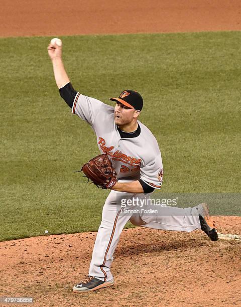 Tommy Hunter of the Baltimore Orioles delivers a pitch against the Minnesota Twins during the ninth inning of the game on July 6 2015 at Target Field...