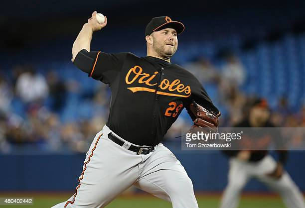 Tommy Hunter of the Baltimore Orioles delivers a pitch in the eighth inning during MLB game action against the Toronto Blue Jays on June 19 2015 at...