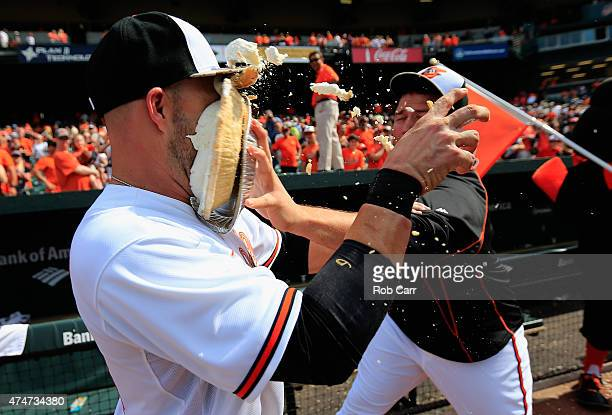 Tommy Hunter of the Baltimore Orioles hits Steve Pearce in the face with a pie following the Orioles 43 win over the Houston Astros at Oriole Park at...