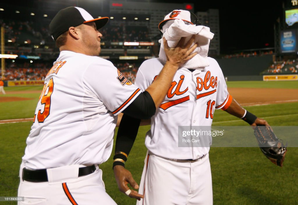 <a gi-track='captionPersonalityLinkClicked' href=/galleries/search?phrase=Tommy+Hunter+-+Baseball&family=editorial&specificpeople=7307047 ng-click='$event.stopPropagation()'>Tommy Hunter</a> #29 of the Baltimore Orioles hits teammate <a gi-track='captionPersonalityLinkClicked' href=/galleries/search?phrase=Adam+Jones+-+Baseball&family=editorial&specificpeople=5460465 ng-click='$event.stopPropagation()'>Adam Jones</a> #10 with a shaving cream pie after the Orioles defeated the New York Yankees 10-6 at Oriole Park at Camden Yards on September 6, 2012 in Baltimore, Maryland.