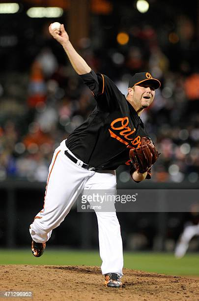 Tommy Hunter of the Baltimore Orioles pitches against the Boston Red Sox at Oriole Park at Camden Yards on April 24 2015 in Baltimore Maryland