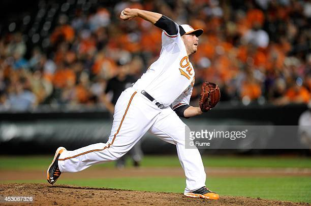 Tommy Hunter of the Baltimore Orioles pitches against the Los Angeles Angels of Anaheim at Oriole Park at Camden Yards on July 31 2014 in Baltimore...