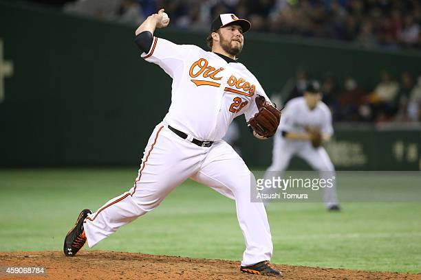 Tommy Hunter of the Baltimore Orioles pitches in the eighth inning during the game four of Samurai Japan and MLB All Stars at Tokyo Dome on November...