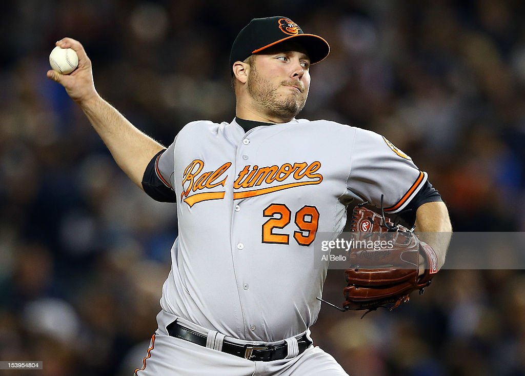 Tommy Hunter #29 of the Baltimore Orioles pitches in the sixth inning of Game Four of the American League Division Series against the New York Yankees at Yankee Stadium on October 11, 2012 in the Bronx borough of New York City.