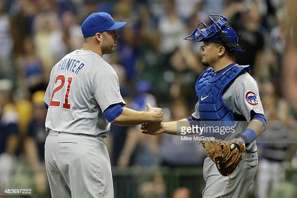 Tommy Hunter of the Chicago Cubs celebrates with Kyle Schwarber after the 41 win over the Milwaukee Brewers at Miller Park on August 01 2015 in...
