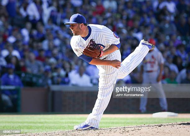 Tommy Hunter of the Chicago Cubs delivers a pitch during the seventh inning against the St Louis Cardinals at Wrigley Field on September 20 2015 in...