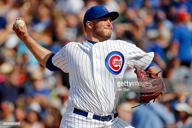 Tommy Hunter of the Chicago Cubs pitches the Milwaukee Brewers during the eighth inning at Wrigley Field on August 13 2015 in Chicago Illinois
