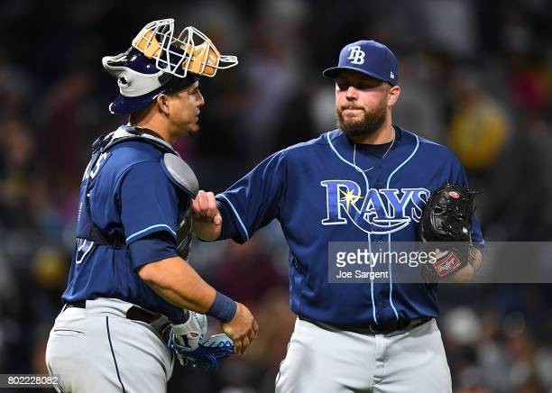 Tommy Hunter of the Tampa Bay Rays celebrates with Wilson Ramos after a 42 win over the Pittsburgh Pirates at PNC Park on June 27 2017 in Pittsburgh...