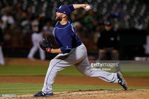 Tommy Hunter of the Tampa Bay Rays pitches against the Oakland Athletics during the eighth inning at the Oakland Coliseum on July 17 2017 in Oakland...