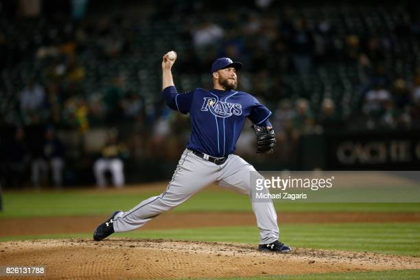 Tommy Hunter of the Tampa Bay Rays pitches during the game against the Oakland Athletics at the Oakland Alameda Coliseum on July 17 2017 in Oakland...